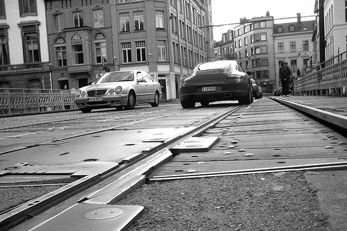Porsche and Mercedes on street